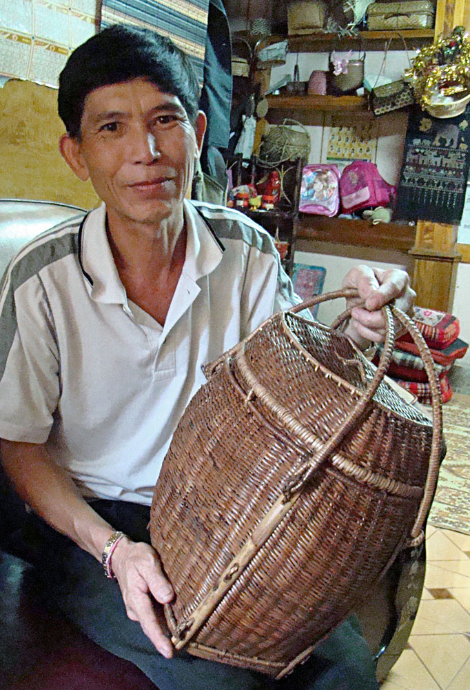 Mr. Siovan holds one of his own baskets.