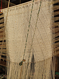 Close up of a vertical pattern heddle.