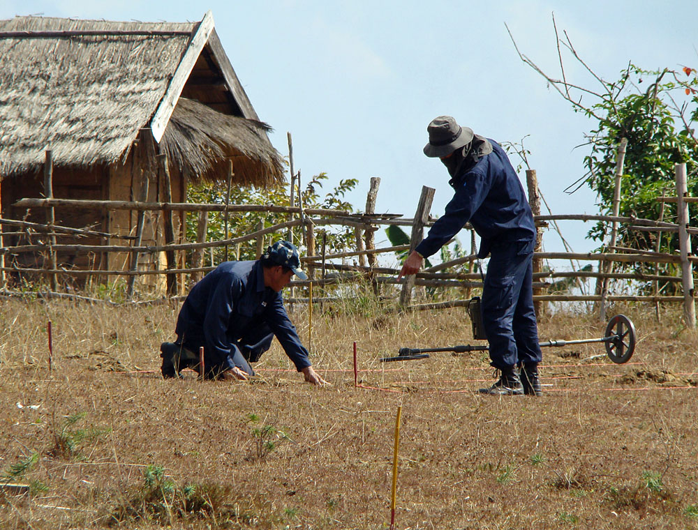 MAG workers clearing a field near Phonsavan, Laos.