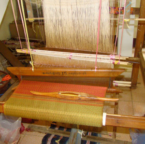 A half-finished shawl on the loom - this weaver was too shy for a photo!