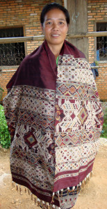Souk modeling one of her intricate healing cloths.