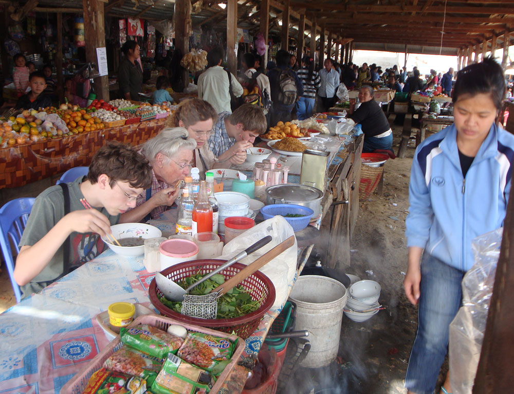 Eating breakfast pho, with grandma, in the Xam Tai market in NE Laos.