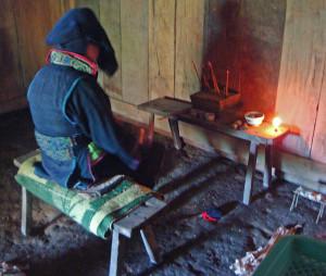 The Hmong shaman mid-trance, chanting to invoke healing spirits.