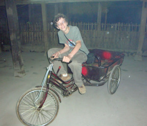 "An utterly absurd ""only Zall"" moment - riding a tricycle cart downstairs at one of our homestays - if he could have brought it home, he would have!  Notice his ever-present camera."