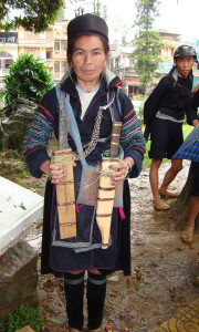 Black Hmong woman selling machetes forged by her husband.