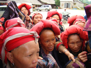 Red Dzao women eager to show their work.