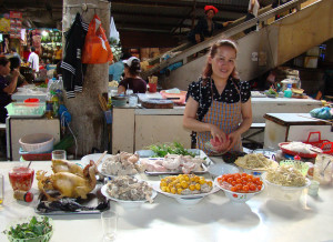"Sho's favorite ""pho lady"" in the Sapa market. On the table are additions to the pho, including raw and cooked eggs, chicken intestines, regular or black chicken meat, morning glory and bamboo shoots."