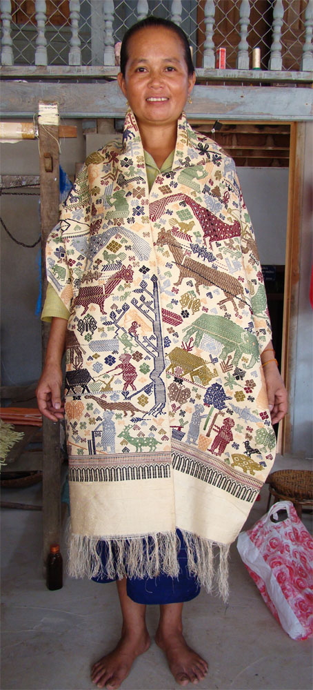 "Chola modeling her ""story cloth"" woven of naturally dyed local silk."