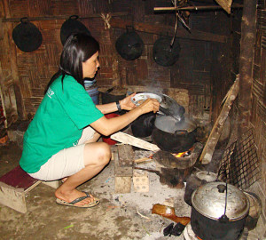Mai, in her separate cooking shed, making eel soup.