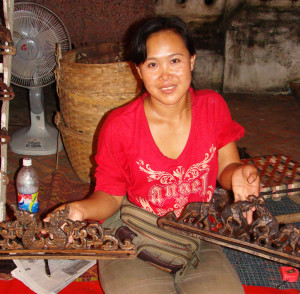 The woman selling the carved wooden hangers.