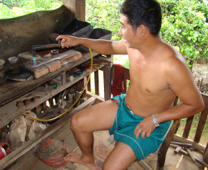 An Akha silversmith shows us his technique.