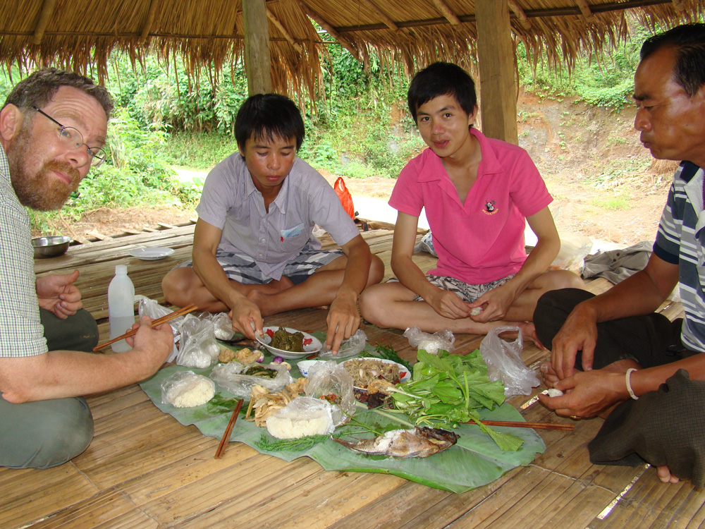 Josh, Tui, Ont (Tui's guide-in-training), and our driver (Tui's new uncle-in-law) digging into a delectable lunch.