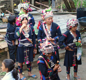 Akha women in full regalia in the town of Pha Home, NW Laos.