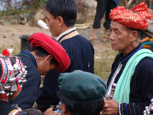 Akha men in full regalia, Pha Home, Laos.