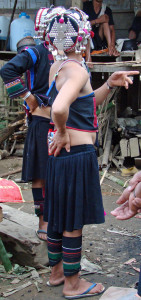 An Akha woman in full traditional garb showing skirt style.