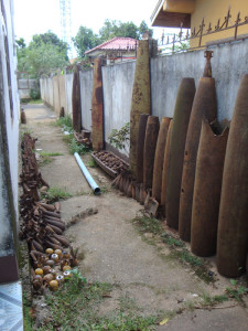 Mortars, bombies, and cluster bomb casings on display outside the tourist office in Phonsavan.