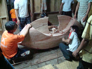 Coffin being tied together with rattan.