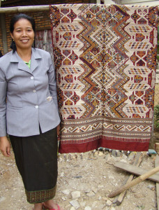 Souk next to one of her complex large shaman cloths (or ceremonial wedding blanket.