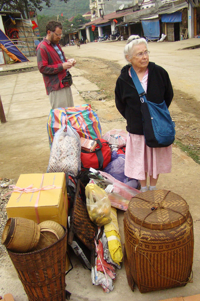 What our gear looks like when crossing a border.  Here, in the border town of Na Meo, Vietnam, Dad and Grandma patiently (!) wait to move onward.  Anyone going east?  Something always works out.