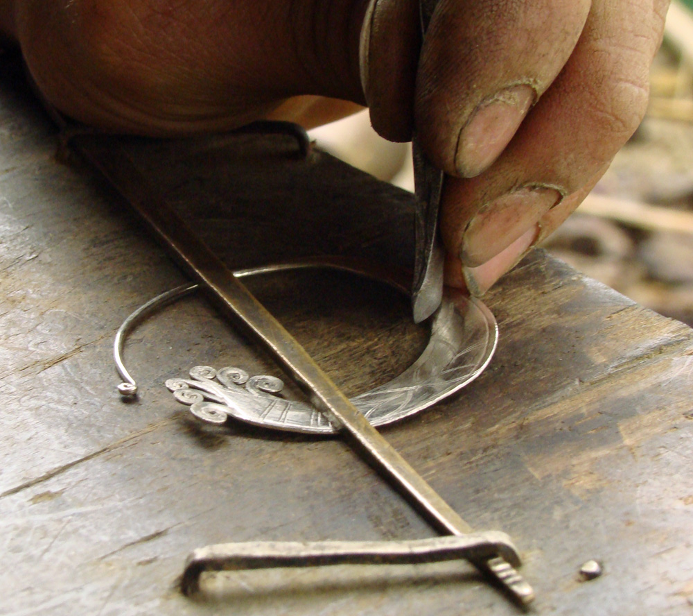 His workbench is a slab of wood, his tools simple, and his workmanship traditional & exquisite.