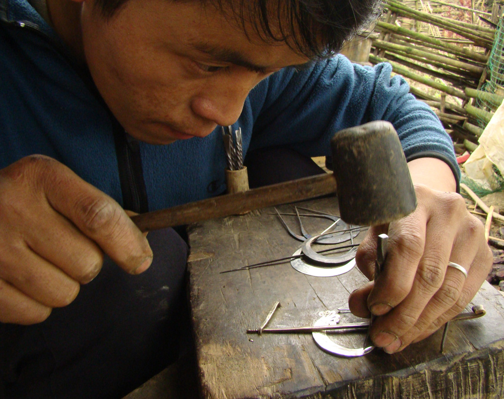 Trang crafting earrings for us to buy that day.
