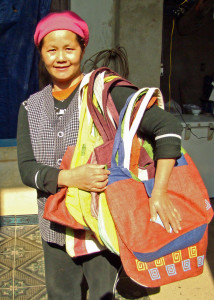 The owner of the hemp shop displaying the bags we bought.