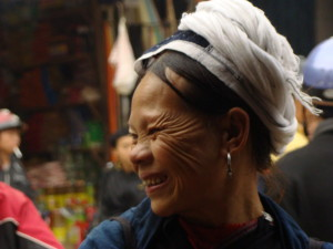 A beautiful San Chi woman at the market.