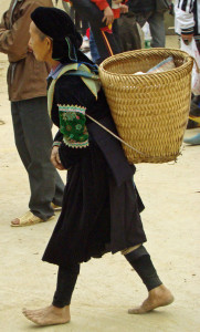 Barefoot Green Hmong woman.