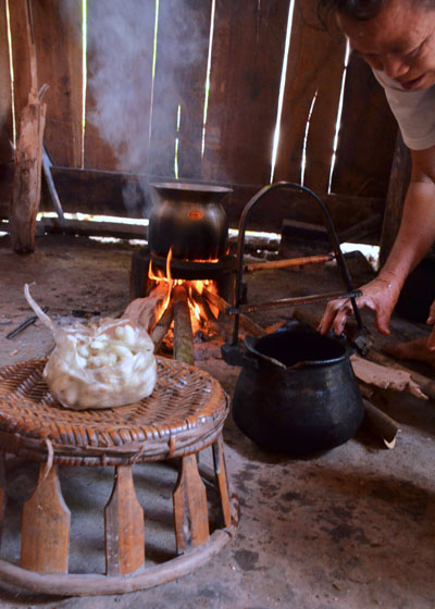 Preparing the hot water and silk cocoons for the demonstration.
