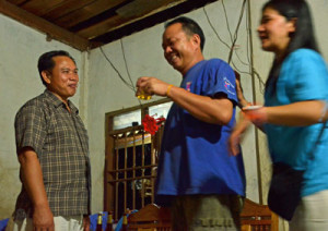 From left to right, the Vice Governor, Souk's husband, and Mai - toasting is an important part of any basi cermony.