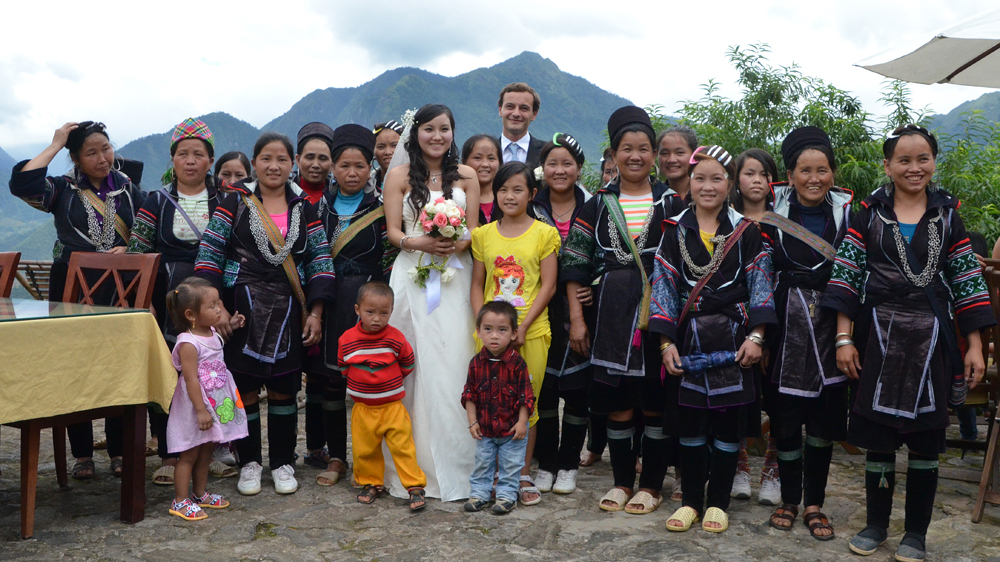 Sho and Antoine with an array of Hmong friends and family.