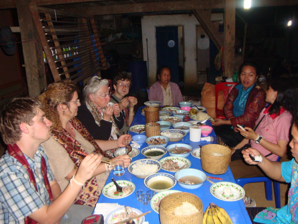 Sharing a meal at Souk's home.  From left to right: Ari, Maen, Josh's mom Joy, Zall, Sukavit (expert weaver and village elder), Phout (blue shirt), and an edge of Souk's face.