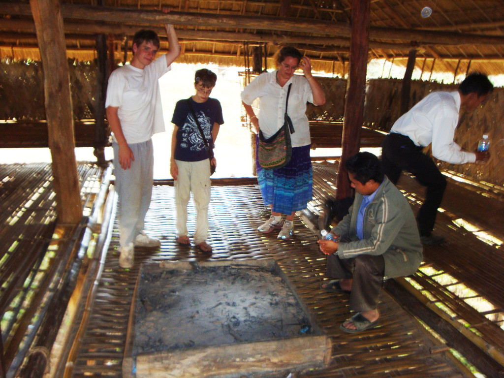 Inside the community house in Attapeu Province in Laos – note the fire pit on the bamboo floor!