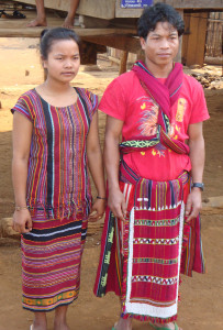 Katu couple in Kadok model a  locally-made ceremonial  beaded skirt and blouse, loincloth, and shoulder cloth (over a t-shirt).