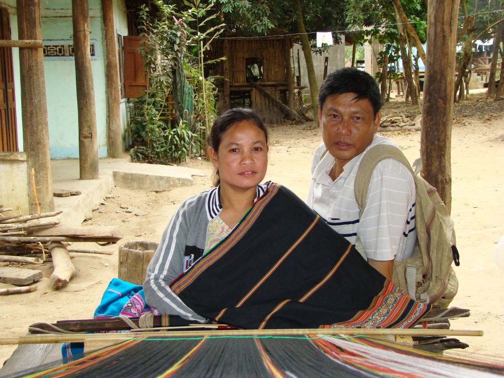 Mr. Vinh with his daughter at the loom.