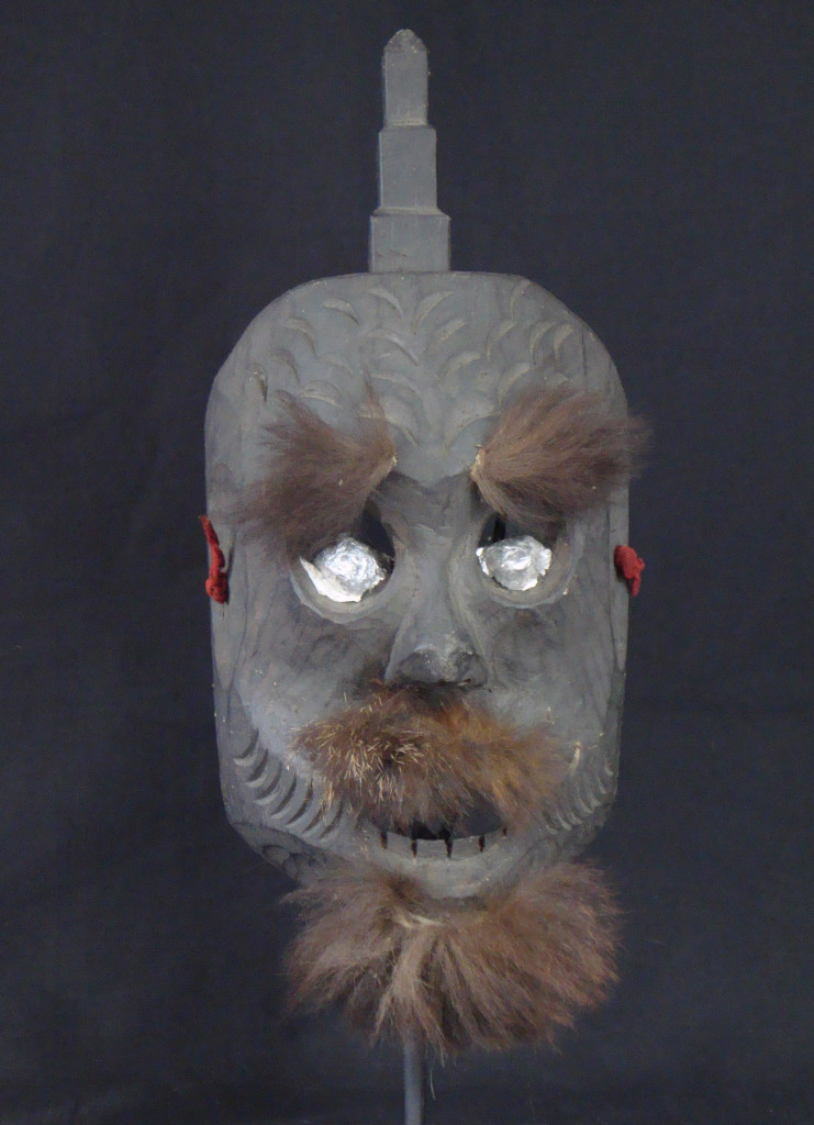 Mun mask with Buddha spike, goat fur facial hair and aluminum foil eyes.