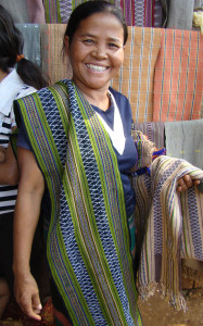 Katu weaver displaying her beaded scarf.