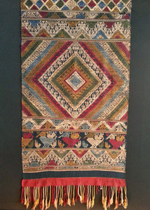 One of the antique Laos textile ends from a shaman cloth which is part of the Tilekke & Gibbons Collection textile collection. Photo courtesy of John Ang.