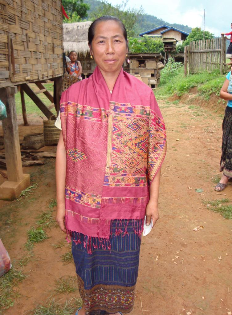Weaver modeling her recently woven Phaa Sabai.
