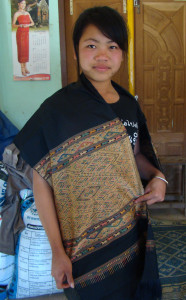 "Young weaver displaying the woman side of her ""man/woman"" healing cloth."
