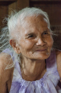 A very elderly weaver in Houaphon Province. She sold us a piece she had woven in her youth.