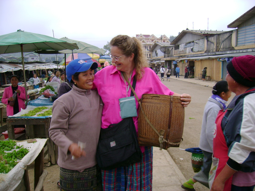 Maren in Xam Neua on our first visit in 2006. Maren literally bought the basket off this woman's back!