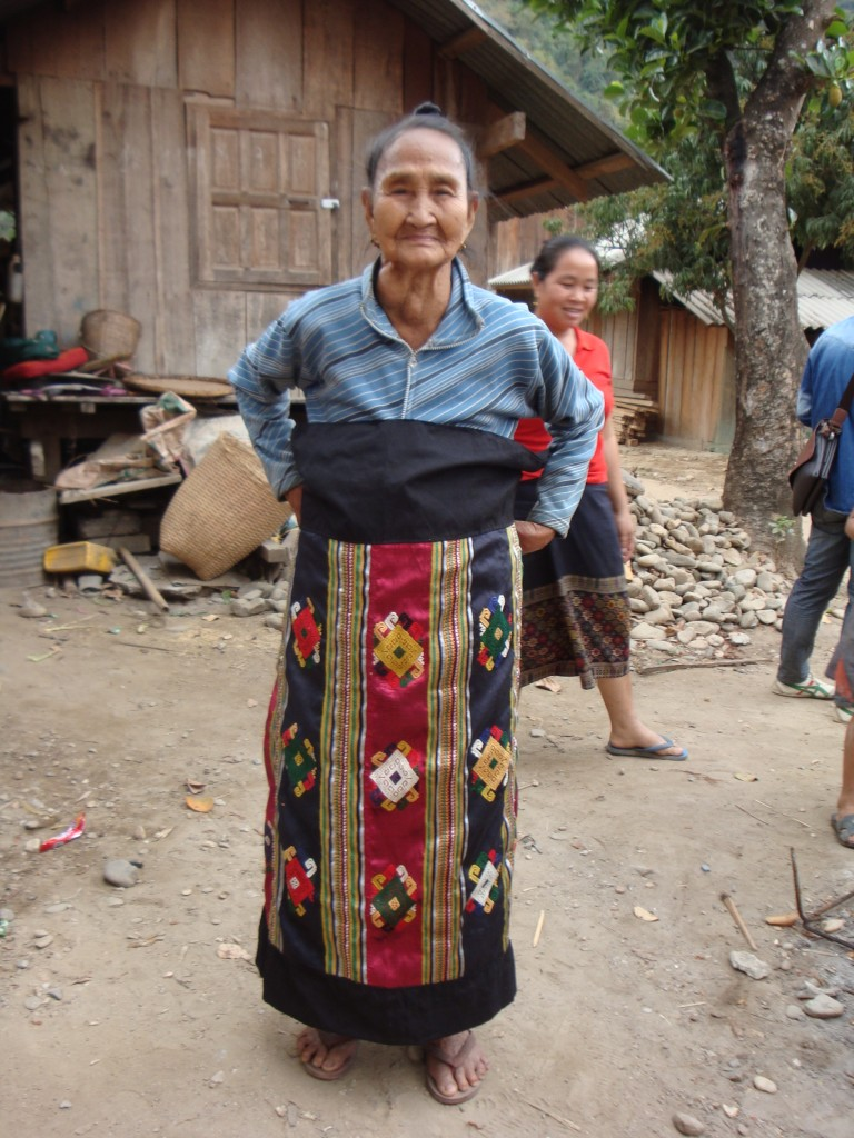 Me Tai Lu (Grandmother Lu) proudly displaying the sinh she wove.