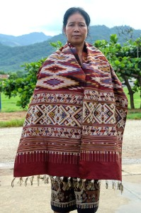 Souksakone, Xam Tai's leading master-dyer, template designer, and weaver.
