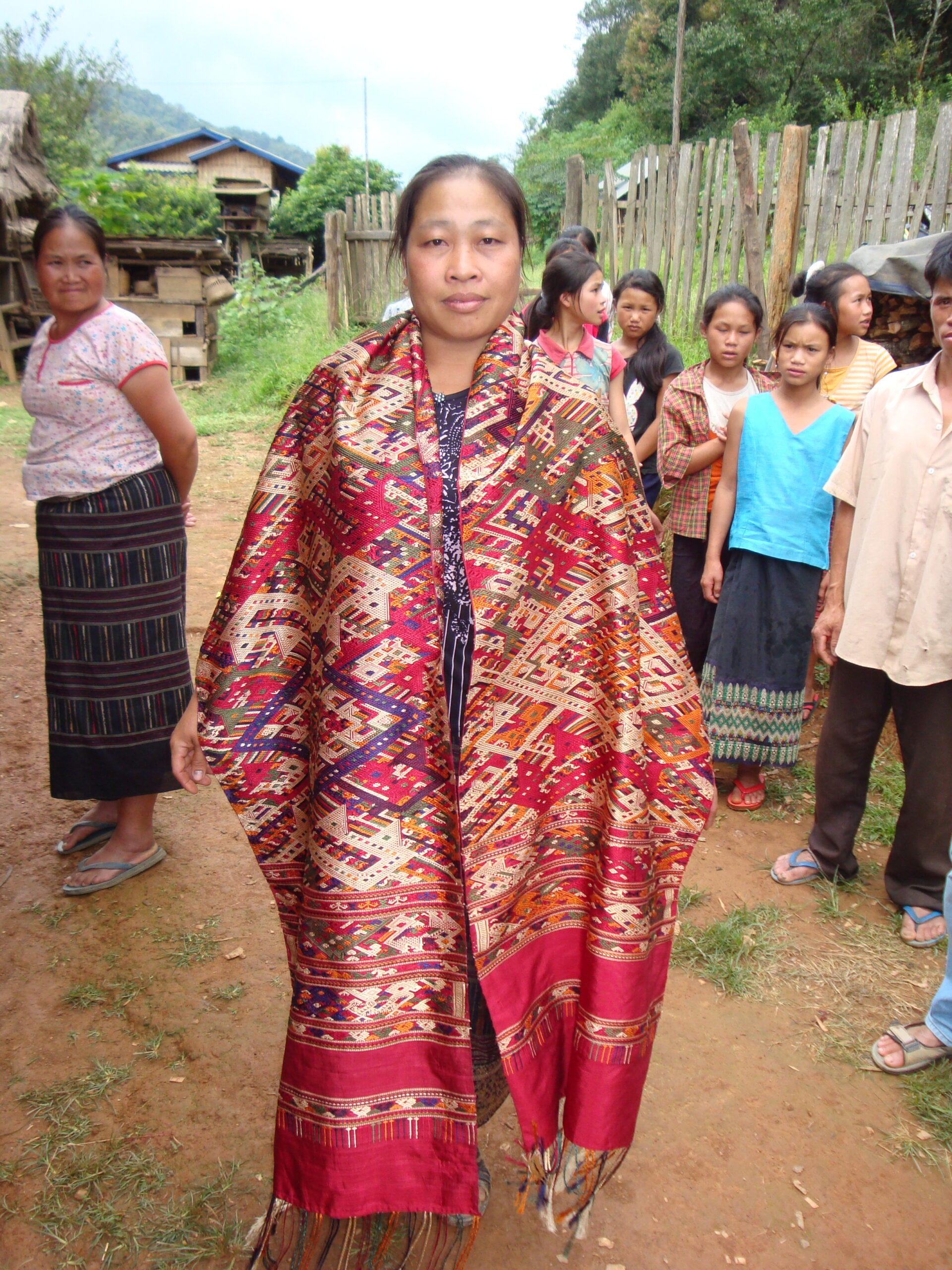 A weaver models her newly-woven shaman's shawl.  The silk is locally-raised and naturally-dyed.