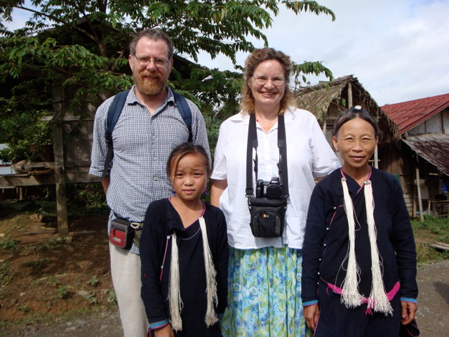 Josh and Maren pose with a Lanten mother and daughter a NW Laos.