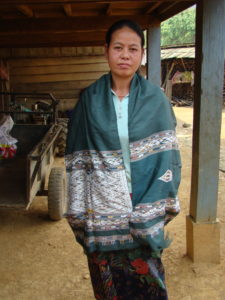 """Another """"man-woman"""" healing cloth from the same region; the weaver is the model."""