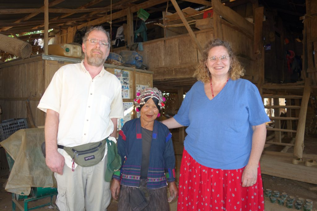 Maren and Josh share some time with a traditional Akha elder in the far NW Laos.