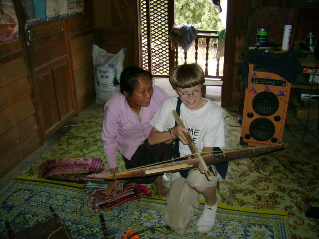 Sukkhavit and Zall playing with the crossbow on our first visit to Xam Tai in 2007.